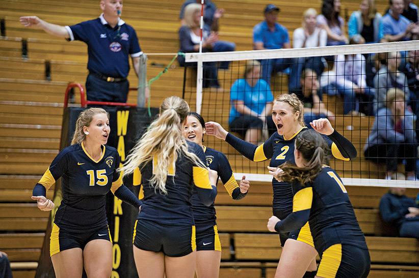 The Waterloo Warriors women's volleyball team takes on the Windsor Lancers in the Athletics Centre at the University of Waterloo. (Photograph by Cole Garside)